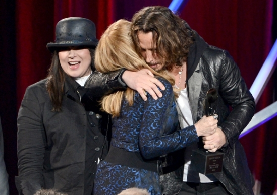 From the Heart: Heart singer Ann Wilson looks on as sister Nancy Wilson hugs presenter Chris Cornell at the 28th Rock and Roll Hall of Fame Induction Ceremony in L.A.