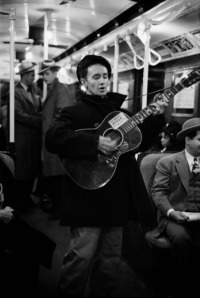 Woody Guthrie performing in a NYC subway circa 1943