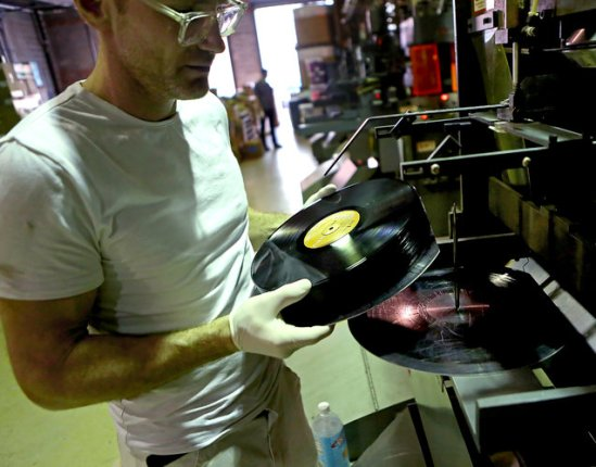 Thomas Bernich, who founded Brooklyn Phono in 2000, at his factory, which he says now produces around 440,000 LPs a year.  Photo: Andrea Mohin