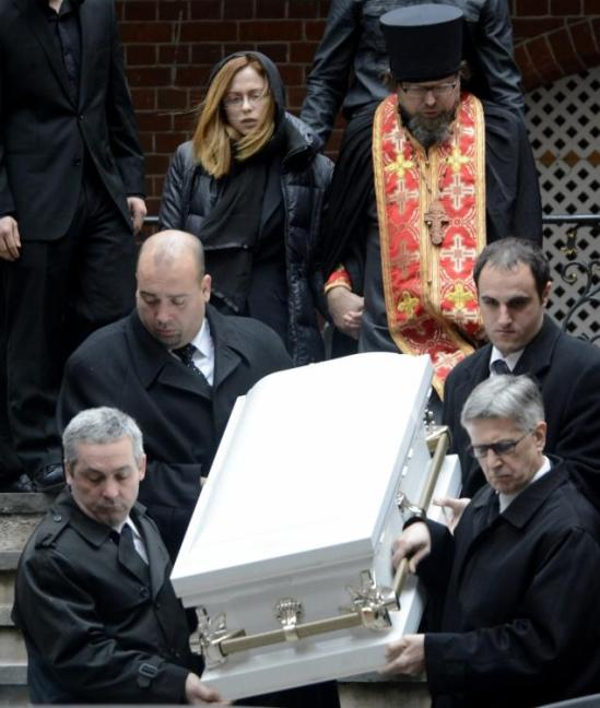 Svetlana Kanarikov walks behind Kirill's white coffin on Thursday outside the Synod Cathedral of the Mother of the Sign on E. 93rd St.