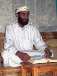 Anwar_al-Awlaki_sitting_on_couch_lightened-400x533