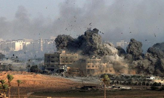 Debris and smoke fill the air during an Israeli strike on Gaza City early on July 26, 2014. (AFP Photo / Gil Cohen Magen)