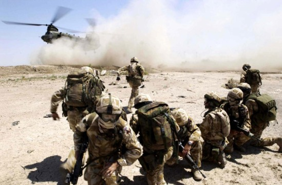 Picture released by the British Defense Ministry shows soldiers from the RECCE and PATROLS Platoon, Fire Support Company of The 1st Battalion The Royal Welch Fusilers (1 RWF) mount heli borne Eagle VCP's (Vehicle Check Points) near the southern Iraqi City of Basra 02 July 2004. (AFP Photo / MOD)