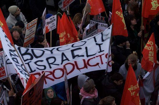 "Haredi Jew in Jerusalem holding a Palestinian flag with the text, ""Boycott Israel"". Haredi Jew holding a Palestinian flag with the text ""Boycott Israel""."