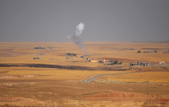 """Smoke rises during clashes between Kurdish """"peshmerga"""" troops and militants of the Islamic State, formerly known as the Islamic State in Iraq and the Levant (ISIL), on the outskirts of Sinjar, west of Mosul, (Reuters / Stringer)"""