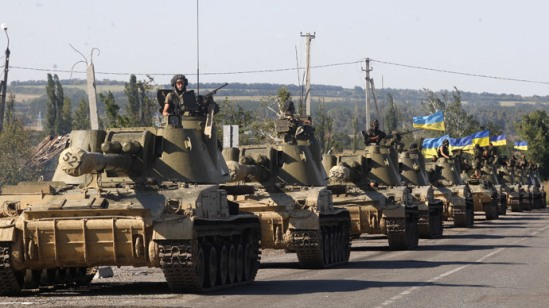 A column of Ukrainian tanks travels in Donetsk region on September 3, 2014.(AFP Photo / Anatolii Stepanov)