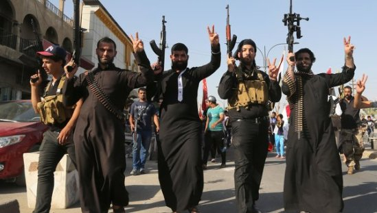 Shiite tribal fighters raise their weapons and chant slogans against the al-Qaida-inspired Islamic State of Iraq and the Levant (ISIL) in the northwest Baghdad's Shula neighborhood, Iraq, Monday, June 16, 2014.