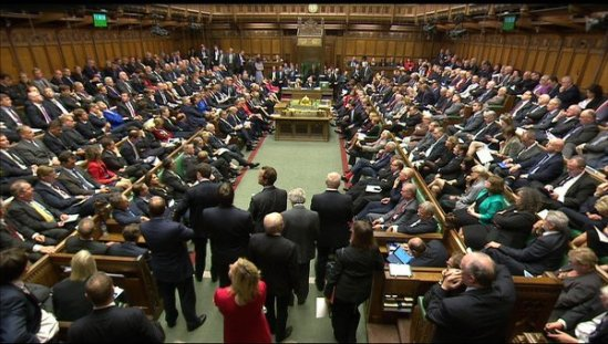 "This image taken from the Parliamentary Recording Unit via Associated Press shows British lawmakers preparing for the debate on air strikes against the Islamic State group in the Houses of Parliament, London, Friday, Sept. 26, 2014. David Cameron told lawmakers ""there is no more serious issue than asking our armed forces to put themselves in harm's way to protect our country"" as he set out the case for British participation in air strikes against Islamic State militants in Iraq."