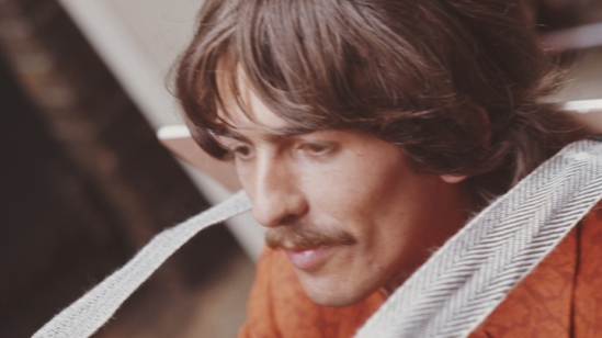 LONDON - 24th JUNE: George Harrison (1943-2001) from The Beatles arrives at EMI Studios in Abbey Road, London for a press call before the recording of 'All You Need is Love' on 24th June 1967. (Photo by Mark and Colleen Hayward/Redferns)