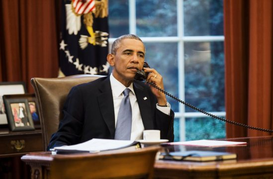 U.S. President Barack Obama speaks on the phone with Saudi Arabia's King Abdullah from the Oval Office of the White House in Washington September 10, 2014. President Barack Obama called Saudi Arabia's King Abdullah on Wednesday ahead of an evening speech in which the U.S. leader plans to lay out his strategy for defeating the militant group Islamic State, the White House said. REUTERS/Kevin Lamarque  (UNITED STATES - Tags: POLITICS CIVIL UNREST CONFLICT TPX IMAGES OF THE DAY)