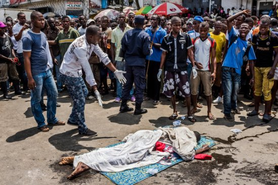 The body of a man thought to have died of Ebola on a Monrovia, Liberia, street on Monday. The Liberian president has implored President Obama to do more. Credit Daniel Berehulak for The New York Times