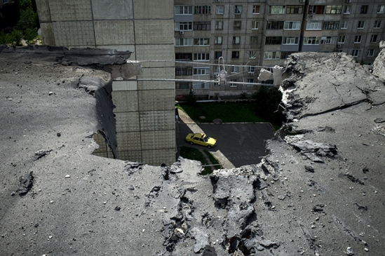 The aftermath of an artillery attack on Lugansk on July 14, 2014. (RIA Novosti / Valeriy Melnikov)