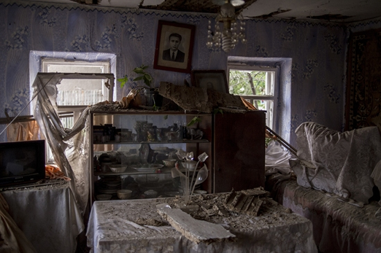 A private house damaged by Ukrainian army's shelling of Lugansk on July 17, 2014. (RIA Novosti / Valeriy Melnikov)