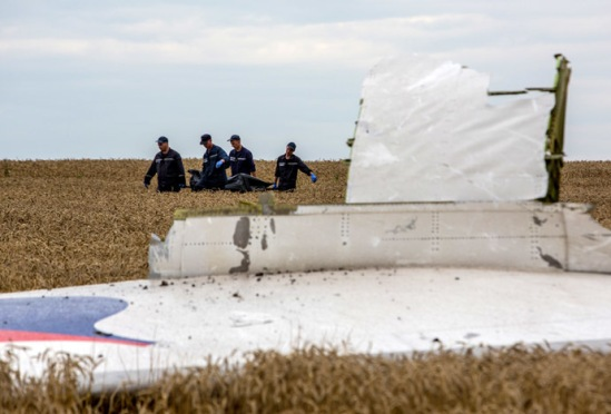 Rescue workers remove bodies of the dead and fragments of the Malaysian Boeing 777 airliner that crashed near the city of Shakhtyorsk in the Donetsk Region. Andrey Stenin/RIA Novosti