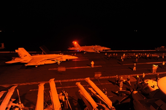 This US Navy photo shows an an F/A-18E Super Hornet, attached to Strike Fighter Squadron (VFA) 31, and an F/A-18F Super Hornet, attached to Strike Fighter Squadron (VFA) 213, as they prepare to launch from the flight deck of the aircraft carrier USS George H.W. Bush (CVN 77)to conduct strike missions against ISIL targets on September 23, 2014 in the Gulf. (AFP Photo / US Navy / Robert Burck / Habdout)