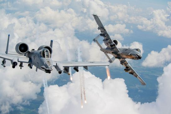 Capts. Andrew Glowa, left, and William Piepenbring launch flares from two A-10C Thunderbolt IIs Aug. 18, 2014, over southern Georgia. Both pilots are with the 74th Fighter Squadron, Moody Air Force Base, Ga. Pilots, maintainers and support Airmen ensure Moody AFB's A-10s stay mission ready for daily training sorties and deployments downrange. (U.S. Air Force photo by Staff Sgt. Jamal D. Sutter/Released)