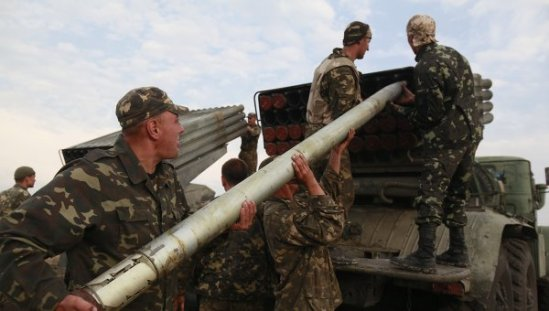 Ukrainian soldiers load a Grad missile in eastern Ukraine.