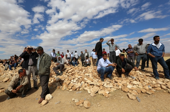 Kurds have watched the fighting from the Turkish side of the border over the last two weeks [AP]