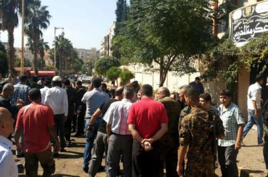Residents and police gathered at the site of the blast [EPA/SANA]