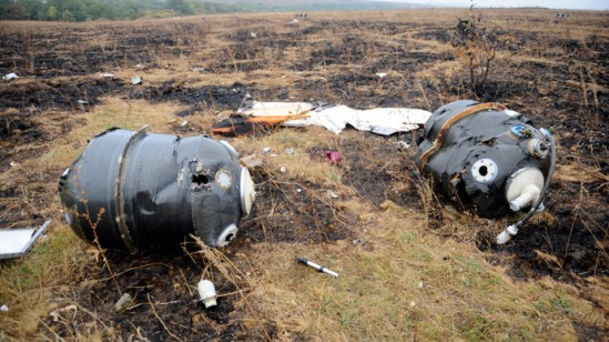 Malaysia Airlines Flight MH17 at the crash site in the village of Hrabove (Grabovo), some 80km east of Donetsk.(AFP Photo / Alexander Khudoteply )