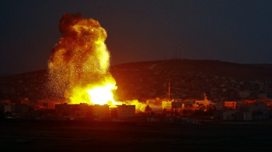 Smoke and flames rise over Syrian town of Kobani after an airstrike, as seen from the Mursitpinar border crossing on the Turkish-Syrian border in the southeastern town of Suruc in Sanliurfa province, October 18, 2014. (Reuters / Kai Pfaffenbach)
