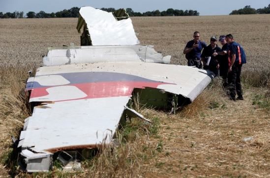 Members of a group of international experts inspect wreckage at the site where the downed Malaysia Airlines flight MH17 crashed, near the village of Hrabove (Grabovo) in Donetsk region, eastern Ukraine August 1, 2014. (Reuters)