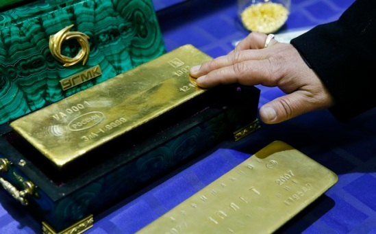 Maxim Shemetov / ReutersAn employee displays a gold bar at a gold refining workshop of the plant of Uralelektromed Joint Stock Company (JSC), the enterprise of Ural Mining and Metallurgical company (UMMC) in the town of Verkhnyaya Pyshma, outside Yekaterinburg, Russia.