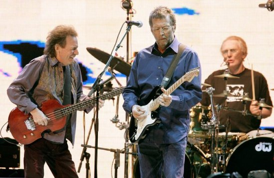 Jack Bruce, left, Eric Clapton and Ginger Baker performing together as Cream in 2005. Credit Brendan Mcdermid/Reuters