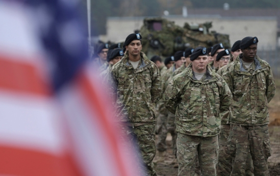 U.S, soldiers deployed in Latvia with the 1st Cavalry Division 1st Brigade Combat team, attend a rotation ceremony at Adazi military base October 14, 2014. REUTERS/Ints Kalnins (LATVIA - Tags: MILITARY) - RTR4A57R