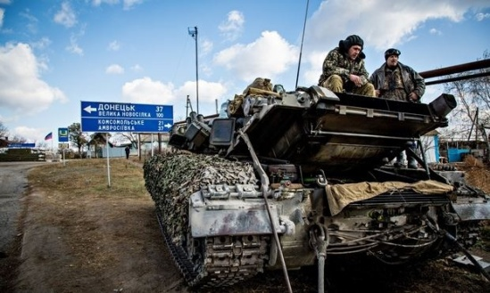 A rebel tank being repaired in Starobeshevo in Donetsk. Ukraine says Russian tanks and trucks have entered the country. Photograph: Petr Shelomovskiy/Demotix/Corbis