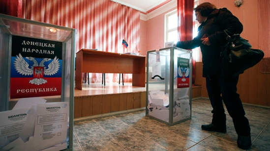 A woman casts a ballot during the self-proclaimed Donetsk People's Republic leadership and local parliamentary elections at a polling station in the coastal settlement of Sedovo, south from Donetsk (Reuters / Maxim Zmeyev)