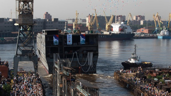 "Launching the stern of the first Russian Mistral type dock assault helicopter carrier ""Vladivostok"" at the Baltic Shipyard. (RIA Novosti/Igor Russak)"