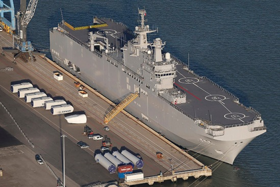 An aerial view shows the Mistral-class helicopter carrier Vladivostok constructed for Russia at the STX Les Chantiers de l'Atlantique shipyard site in the port of Montoir-de-Bretagne near Saint Nazaire