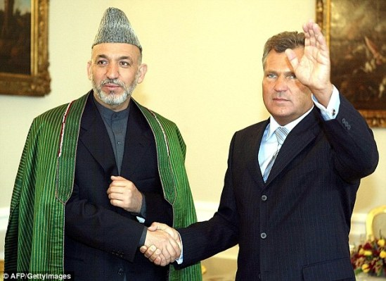 Admission: Former Polish president Aleksander Kwasniewski (pictured right, alongside former Afghan leader Hamid Karzai) today confirmed that Poland granted permission for a secret CIA prison in the country Read more: http://www.dailymail.co.uk/news/article-2867879/CIA-paid-Poland-ease-qualms-secret-prison-Senate-report.html#ixzz3Ld1XSsqq Follow us: @MailOnline on Twitter | DailyMail on Facebook