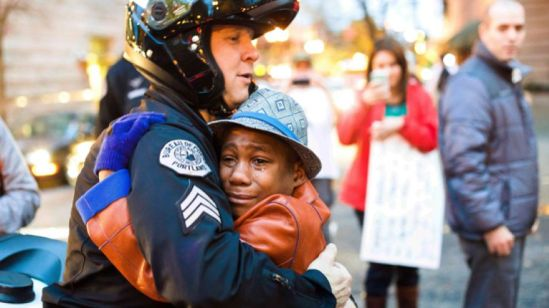 Nov. 25: Portland police Sgt. Bret Barnum, left, and Devonte Hart, 12, hug at a rally in Portland, Ore., where people had gathered in support of the protests in Ferguson, Mo. (AP Photo/Johnny Huu Nguyen)