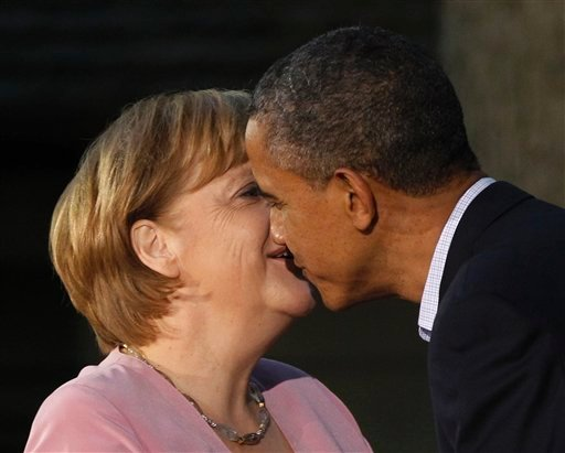 President Barack Obama gives German Chancellor Angela Merkel a kiss on the cheek on arrival for the G8 Summit Friday, May 18, 2012, at Camp David, Md. (AP Photo/Charles Dharapak)