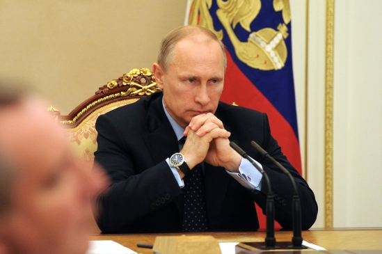 Russia's President Putin chairs a meeting with government members at the Kremlin in Moscow