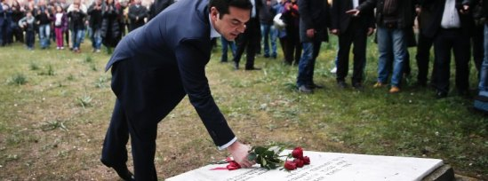 Greece's Prime Minister Alexis Tsipras leaves some flowers on a monument during a ceremony at the Kessariani shooting range site where hundreds of members of the Greek Resistance were executed by Nazi occupation forces during World War II in Athens January 26, 2015. Tsipras laid flowers at the monument following a swearing-in ceremony as Greece's first leftist Prime Minister. REUTERS/Alkis Konstantinidis