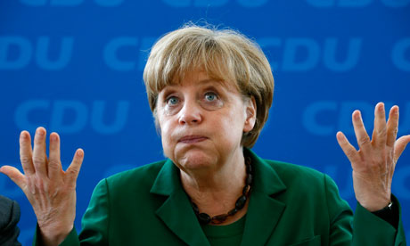 Angela Merkel reacts before a party board meeting in Berlin