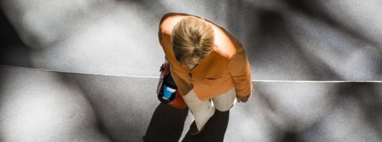 """German chancellor Angela Merkel leaves after a session at the Bundestag lower house of parliament on the Greek crisis on July 1, 2015 in Berlin. German Chancellor Angela Merkel said that """"the future of Europe is not at stake"""" because of the crisis over Greece after the breakdown of debt talks and expiry of its aid programme. AFP PHOTO / ODD ANDERSEN"""