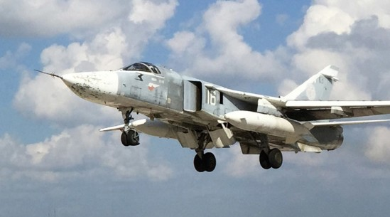 2713698 10/07/2015 A Russian Sukhoi Su-24 lands at the Hmeimim air base in Syria. Dmitriy Vinogradov/Sputnik