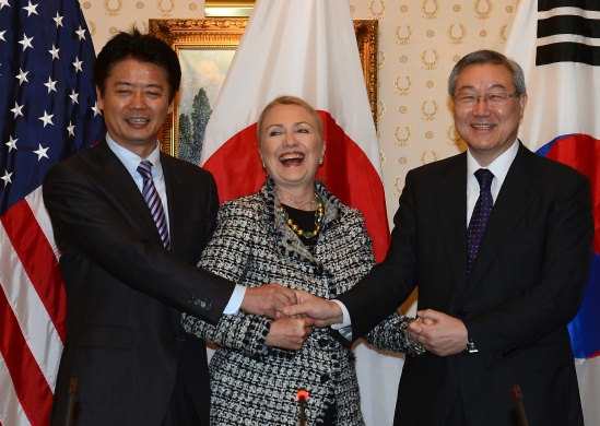 US Secretary of State Hillary Clinton (C) meets with Japanese Foreign Minister Koichiro Gemba (L) and South Korean Foreign Minister Kim Sung-hwan during a tri-lateral aside the 67th UN General Assembly in New York, September 28, 2012. AFP PHOTO/Emmanuel DUNAND (Photo credit should read EMMANUEL DUNAND/AFP/GettyImages)