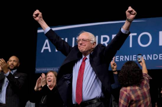 Democratic presidential candidate Sen. Bernie Sanders, I-Vt., center, acknowledges the cheering crowd after a rally Friday, Feb. 19, 2016, in Henderson, Nev. The Democratic presidential candidate has preferred rabble-rousing to the schmoozing required to get bills passed. So it's not surprising that his 25-year congressional career is defined by what he's opposed _ big banks, the Iraq War, the Patriot Act, tax cuts for the wealthy _ rather than what he's accomplished. (AP Photo/Jae C. Hong)