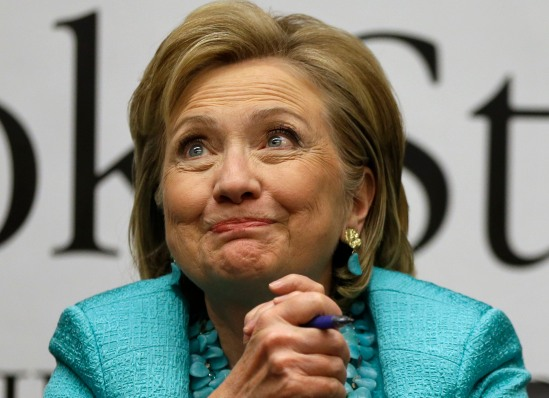 "Former Secretary of State Hillary Rodham Clinton listens to a customer signing copies of her new book ""Hard Choices,"" at Harvard Book Store, Monday, June 16, 2014, in Cambridge, Mass. (AP Photo/Steven Senne)"